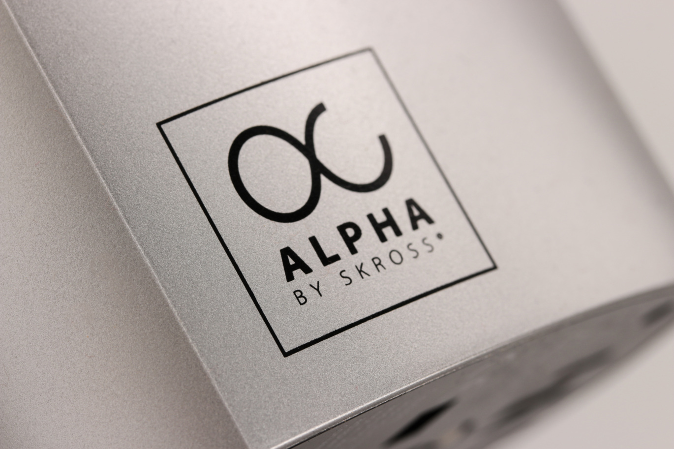 Alpha by SKROSS logo